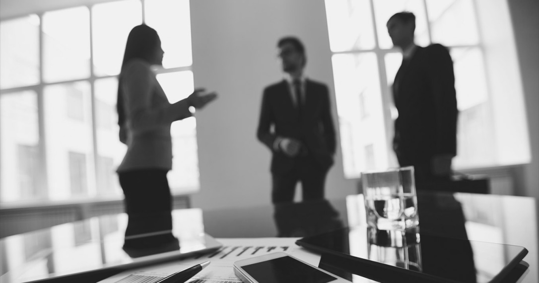 meeting-with-table-in-foreground-grayscale